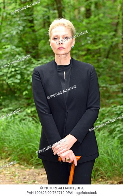 """21 June 2019, Italy, Eppan: The actress Susanna Simon as governor Giulia Santorro stands in the woods during the shooting of """"""""Bozen-Krimi - Tödliche Stille""""""""..."""