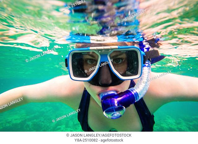 Woman snorkeling off the coast of Coron Island at Coral Eden, Palawan, Philippines
