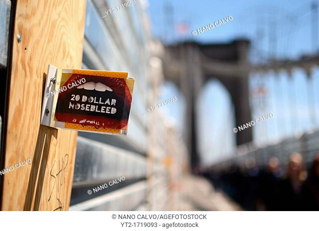 20 Dollar Nose Bleed sticker on Brooklyn Bridge, New York