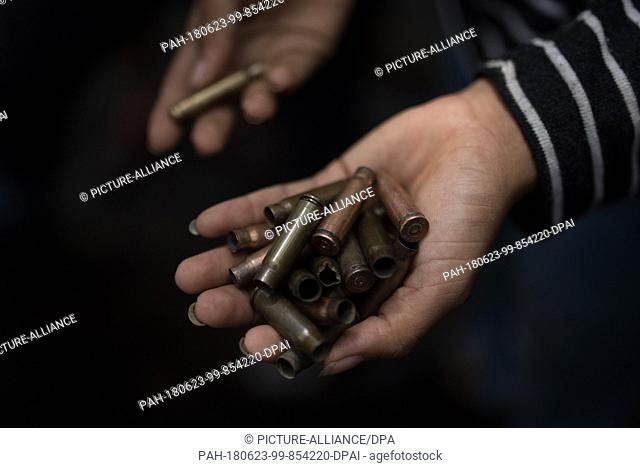 23 June 2018, Nicaragua, Managua: A student shows bullets fired at them in the university area. Paramilitaries stormed the National Autonomous Universities of...