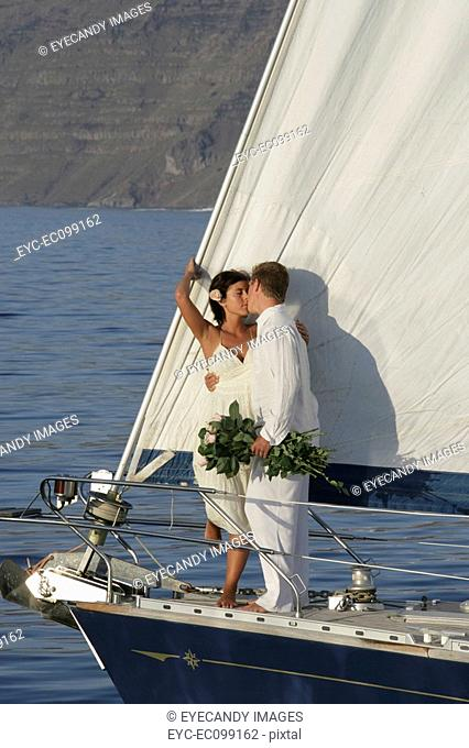 Young couple kissing on a watercraft