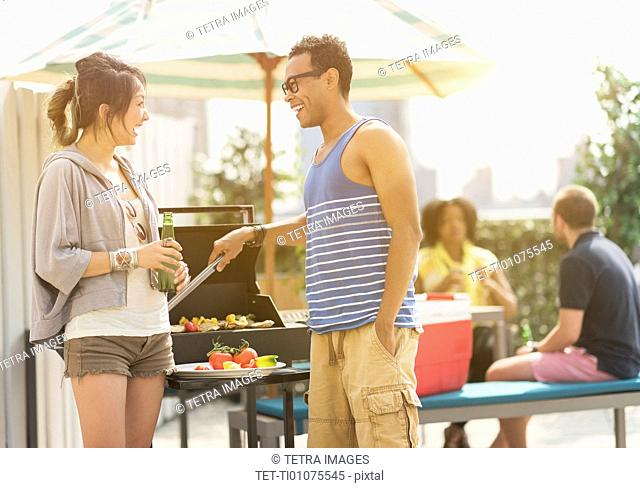 Group of friends enjoying barbeque
