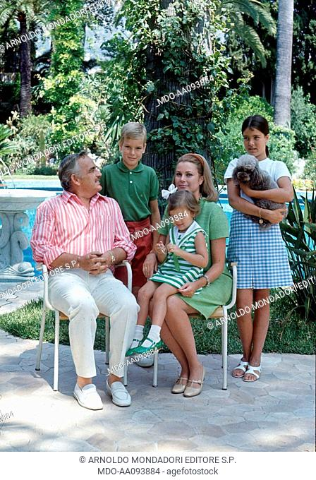 The royal family in a garden. Prince Rainier III of Monaco sitting in a garden with his wife, the American actress Grace Kelly, and his children Albert