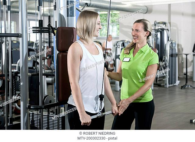Woman fitness studio trainer sport assistance