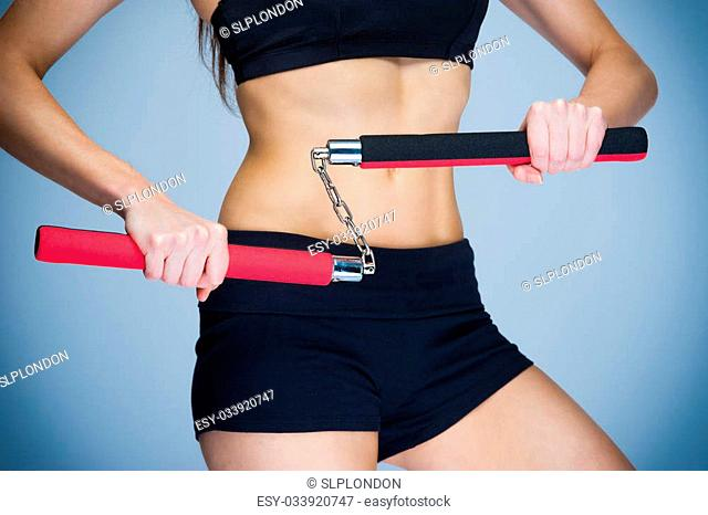 Fit woman traing for self defence. Karate fitness workout
