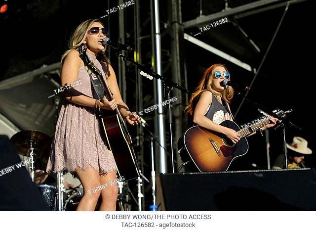 Singer Taylor Dye (L) and Madison Marlow of Maddie and Tae perform during the 4th ACM Party For A Cause Festival at the MGM Festival Grounds on April 1