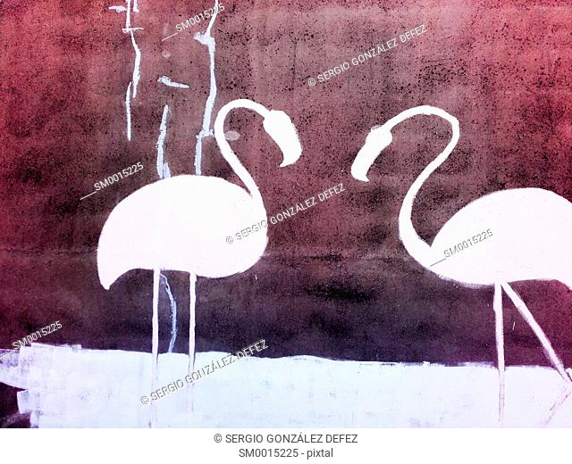 Abstract image of a couple of pelicans in a wall with reddish and black tones. Image in horizontal