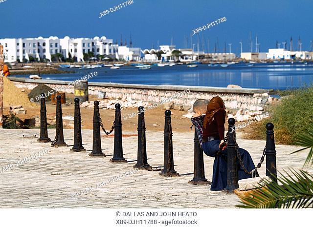 Africa, Tunisia, Djerba Island, Mediterranean Sea, Local Woman Looking Towards Houmt Souk