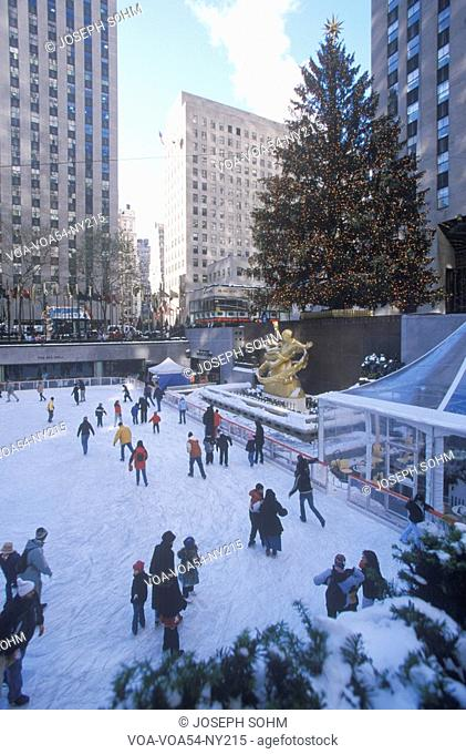 Rockefeller Square with snowy ice skating rink and Christmas tree in mid-town Manhattan, NY