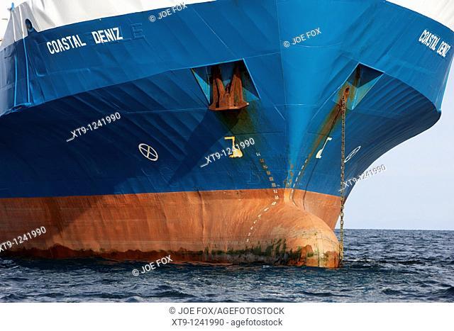 bulbous bow and anchors coastal deniz dry cargo hazard a major ship at anchor in coastal waters of the uk