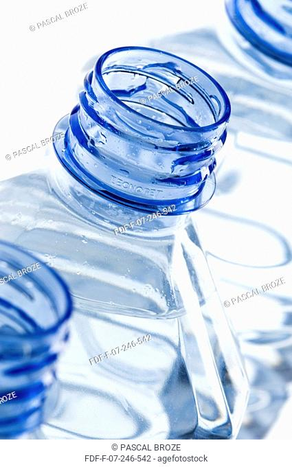 Close-up of three open water bottles in a row