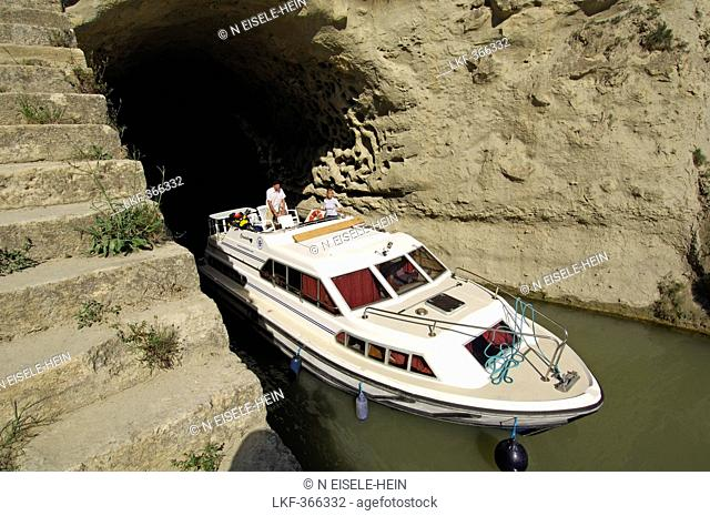 Boat coming out of the tunnel, Tunnel de Malpas, Canal du Midi, Midi, France