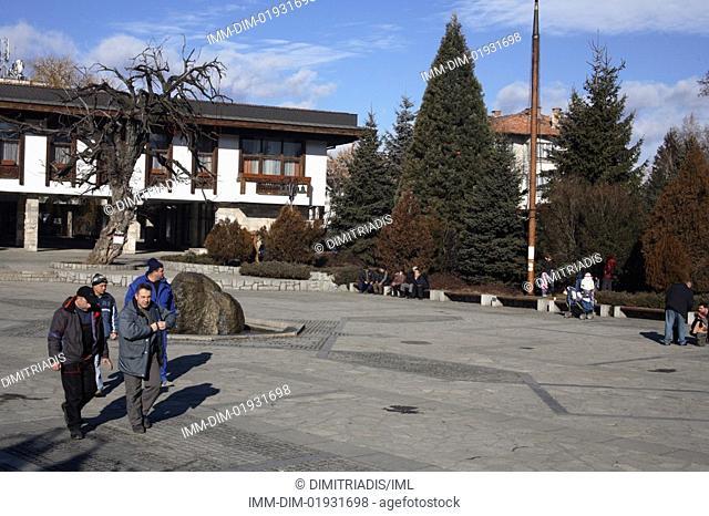 Square, men walking, Bansko, Bulgaria, Europe