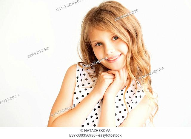 Closeup portrait of a lovely little girl against a white background
