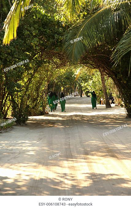 Woman on the road, Maledives