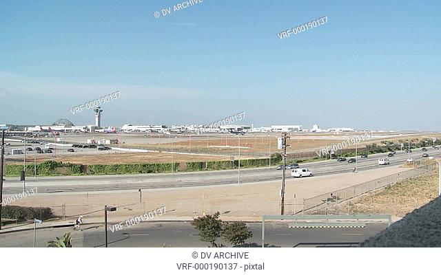 A wide shot of planes take off and taxi at Los Angeles International Airport