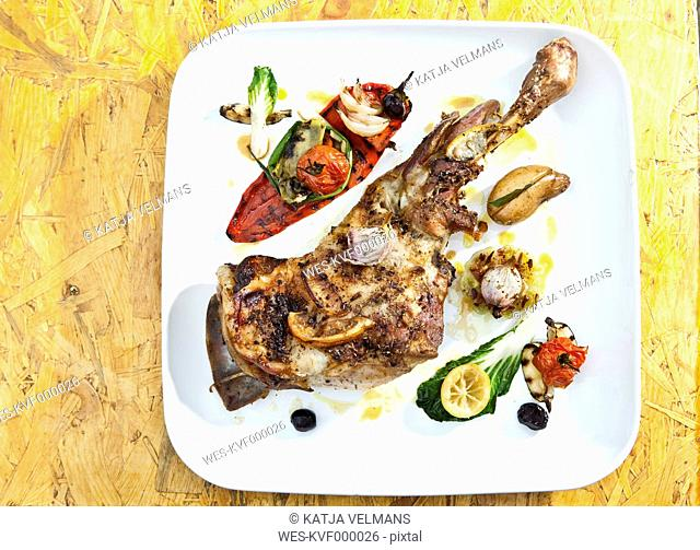 Germany, Duesseldorf, Plate of grilled leg of lamb with vegetables