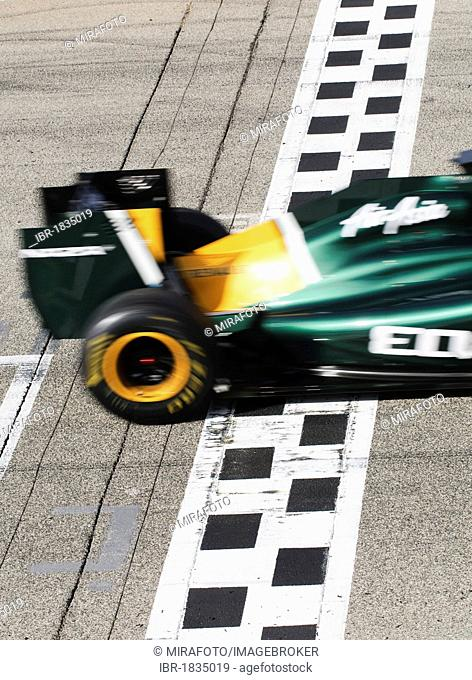 Jarno Trulli, ITA, crossing the finish-line while driving the Lotus T128 during the Formula 1 test-drive at the Circuit Ricardo Tormo near Valencia, Spain