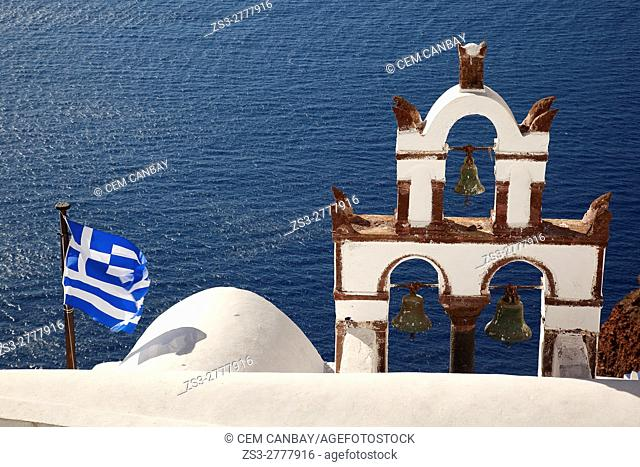 Bell tower and Greek flag of a church in Oia village, Santorini, Cyclades Islands, Greek Islands, Greece, Europe