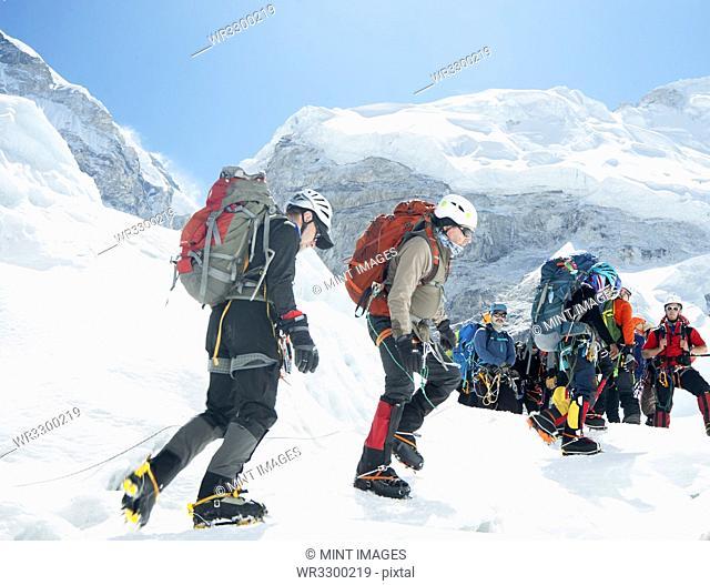 Hikers backpacking on mountain, Everest, Khumbu region, Nepal