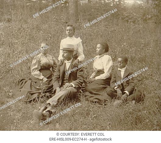 Middle class African American family seated on lawn in Georgia, ca. 1899
