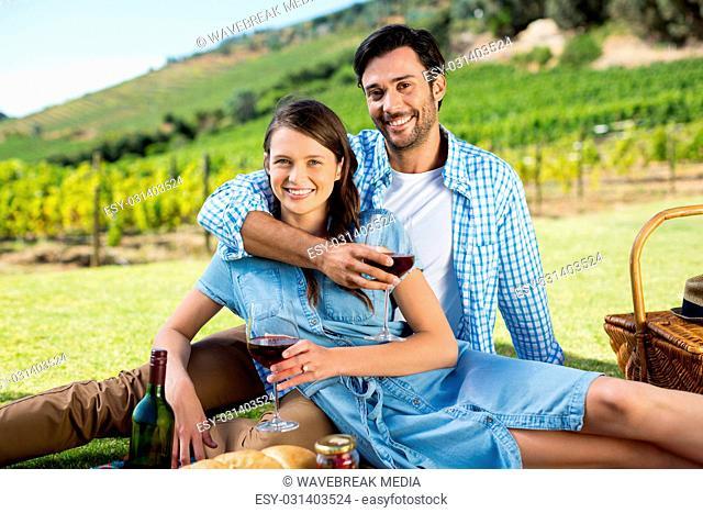 Portrait of smiling couple holding wineglasses