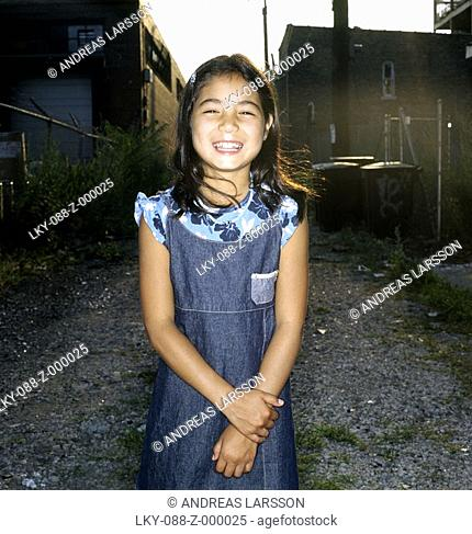 Portrait of young Asian girl in empty lot