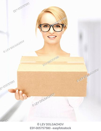 picture of happy woman with cardboard box
