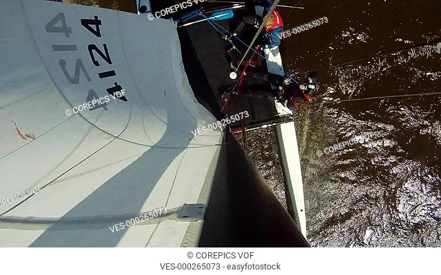 When one of the crew washes overboard, the helmsman lets the catamaran capsize, seen from the top of the mast