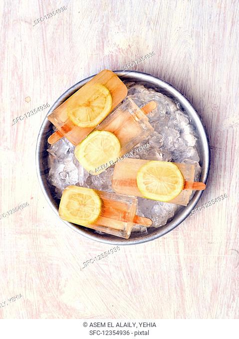 Homemade lemon popsicles on sticks