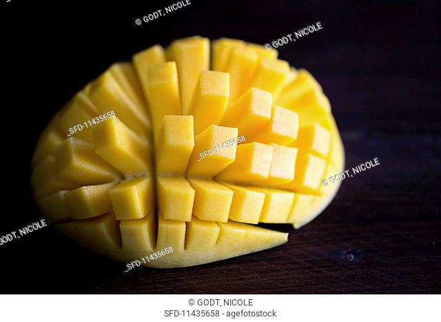 A halved, fanned-out mango