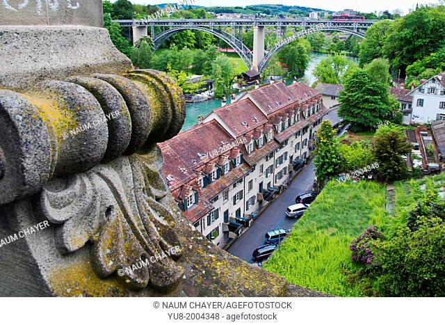 View from bridge:old city with roofs, river and bridge in rainy day, Bern, Switzerland, Europe