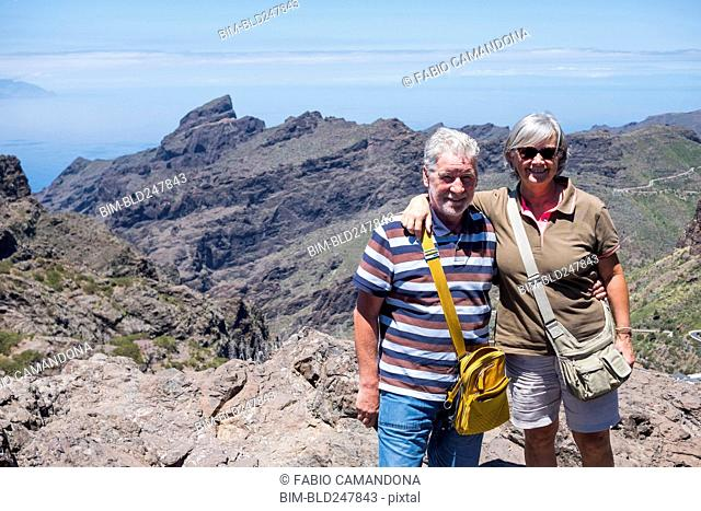 Portrait of smiling older Caucasian couple on mountain