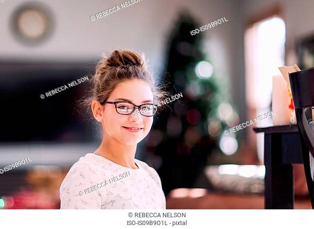 Girl with Christmas tree in background