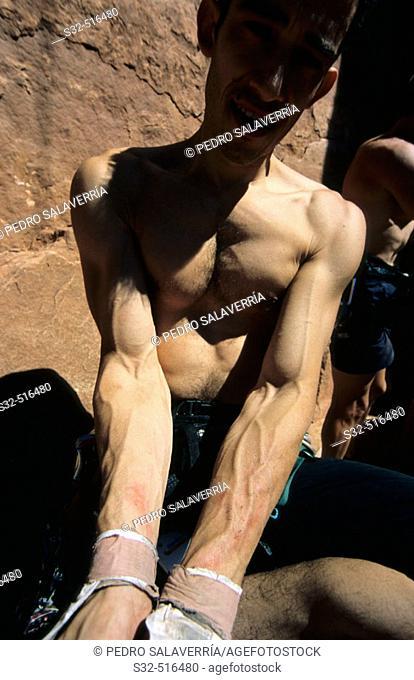 Roberto Largo showing his wounded arms after climbing 'Supercrack' (5.10). Indian Creek. Utah. USA