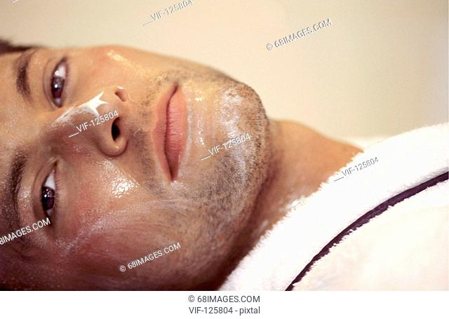 Wellness - Muk Abhyanga - young man relaxing after a facial massage. - HAMBURG, GERMANY, 20/09/2005