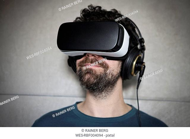 Man wearing Virtual Reality Glasses and headphones