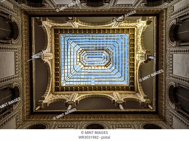 Interior low angle view of dome with skylight, Alcazar de Seville, Andalusia, Spain