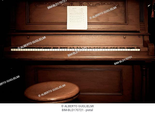 Empty piano with sheet music
