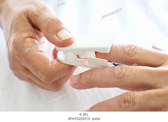 Nurse applying pulse oximeter