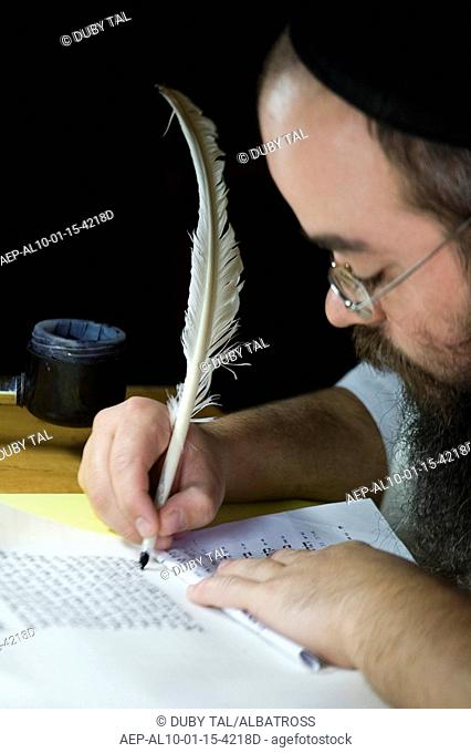 Photograph of an Orthodox Jew copying the bible - ana ancient Jewish profession