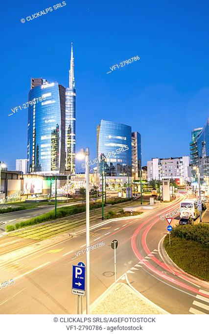 Milan, Lombardy, Italy. Skyscrapers of Porta Nuova business district at dusk with passing cars lights