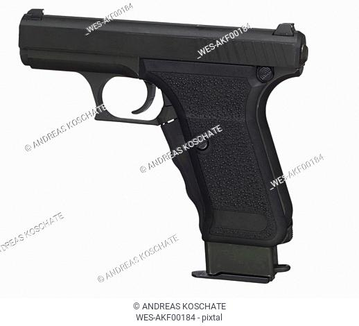 Close up of pistol against white background