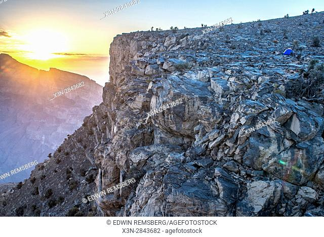 Jebel Shams; Sun shines over the summit and gorge at Oman's Grand Canyon