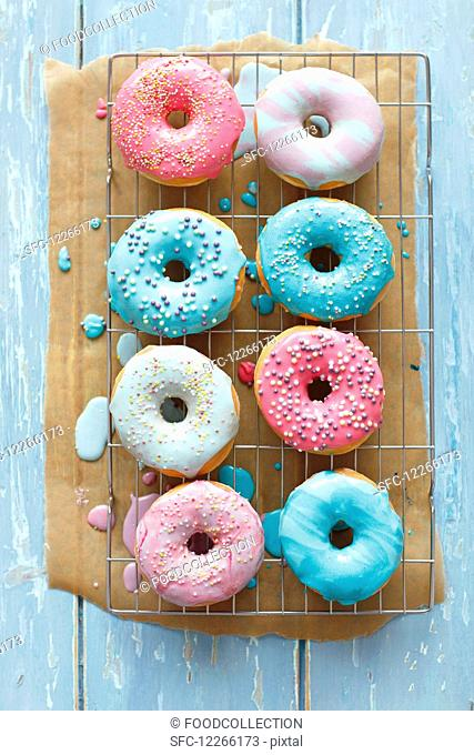Doughnuts with a colorful sugar glaze and sugar balls