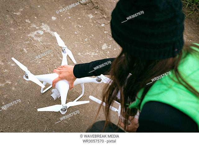 Woman placing drone before take off