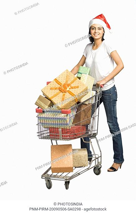 Woman pushing a shopping cart of gifts