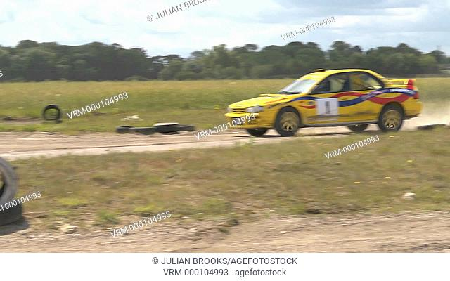 Rally car cornering - Subaru Impreza, lots of dust - from outside the turn