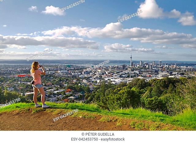 Tourist taking photos of the view of Auckland, New Zealand