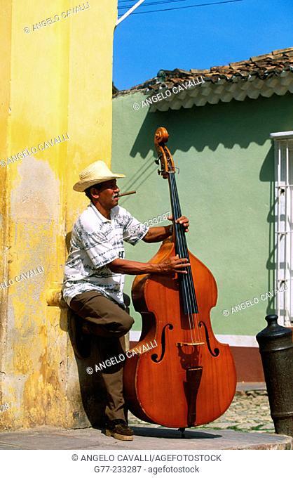 Bass player in a street of Trinidad de Cuba. Cuba